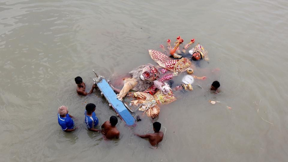 Municipal workers push an idol of the Hindu goddess Durga after it was immersed in the waters of Ganges river after the end of the Durga Puja festival in Kolkata. (Rupak De Chowduri / REUTERS)