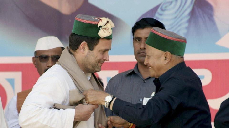 Himachal Pradesh CM Virbhadra Singh (right) welcomes Rahul Gandhi during a rally in Mandi on Saturday.
