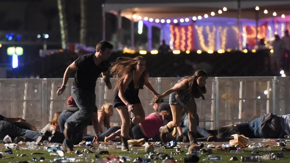 People run from the Route 91 Harvest country music festival after gun fire was heard on  in Las Vegas, Nevada.  (David Becker / AFP)