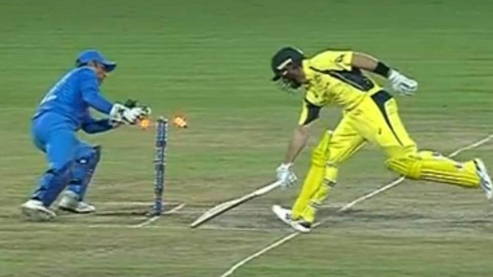 Video grab of Indian cricket team skipper Virat Kohli's accurate throw from the outfield that got the wicket of Australia cricket team's Dan Christian, amusing MS Dhoni (left), during the first T20I in Ranchi on Saturday.