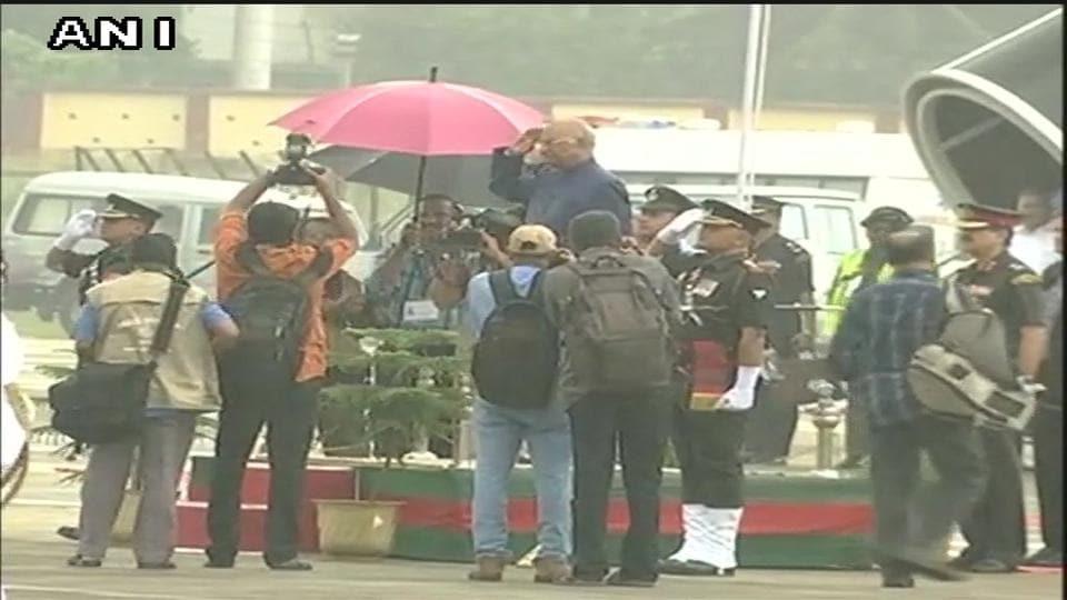 President Ram Nath Kovind takes the salute at the Thiruvananthapuram airport. (ANITwitter)