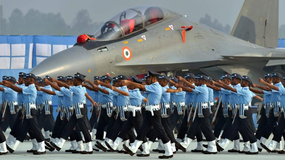 Indian Air Force personnel next to the Sukhoi-30 MKI fighter plane during the 85th Air Force Day celebrations. (Kamal Kishore / PTI)