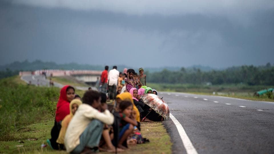 Refugees wait on a road in Bangladesh's Ukhia district on September 28, 2017.