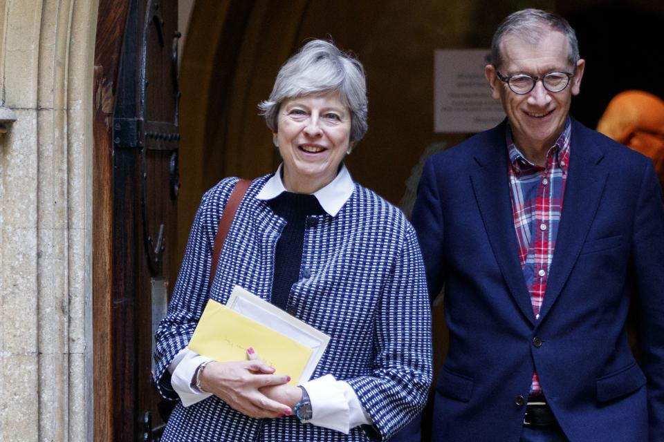 British Prime Minister Theresa May and her husband Philip May after attending the Sunday morning service at a church on October 8, 2017.