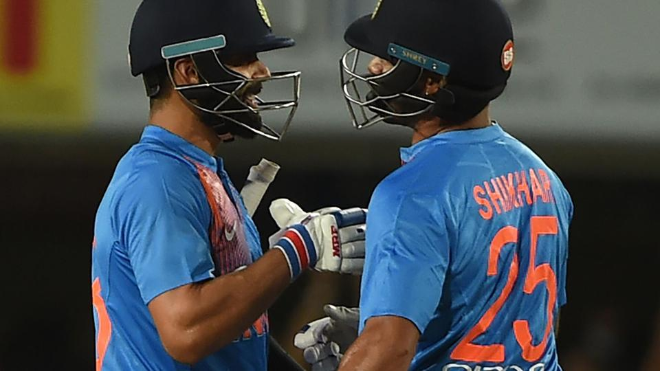 Indian cricket team captain Virat Kohli (L) and Shikhar Dhawan celebrate after beating Australia cricket team in the first T20I at The JSCA International Stadium in Ranchi on Saturday. Spinner Kuldeep Yadav led an inspired bowling effort to help India beat Australia by nine wickets in the rain-shortened first Twenty20 international.