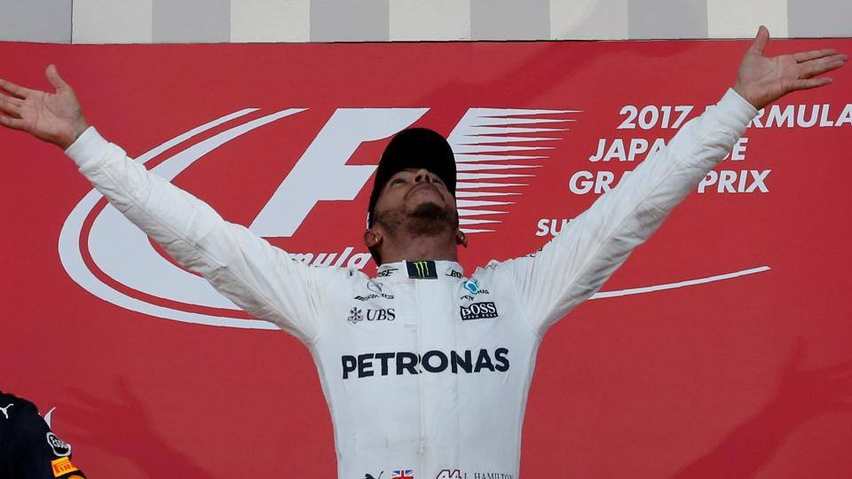 Formula One F1 - Japanese Grand Prix 2017 - Suzuka Circuit, Japan - October 8, 2017. Mercedes' Lewis Hamilton of Britain celebrates winning the race. REUTERS/Toru Hanai