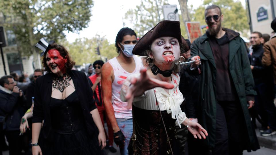 Participants attend the 'Zombie Walk' in Paris on October 7, 2017.  (AFP)