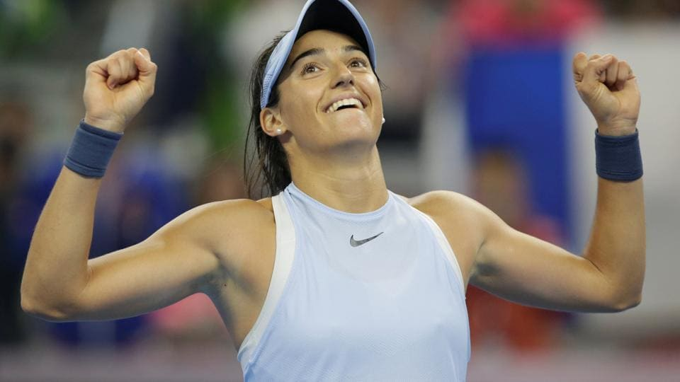 Caroline Garcia of France celebrates after beating Simona Halep of Romania in China Open tennis tournament women's singles final in Beijing on Sunday.