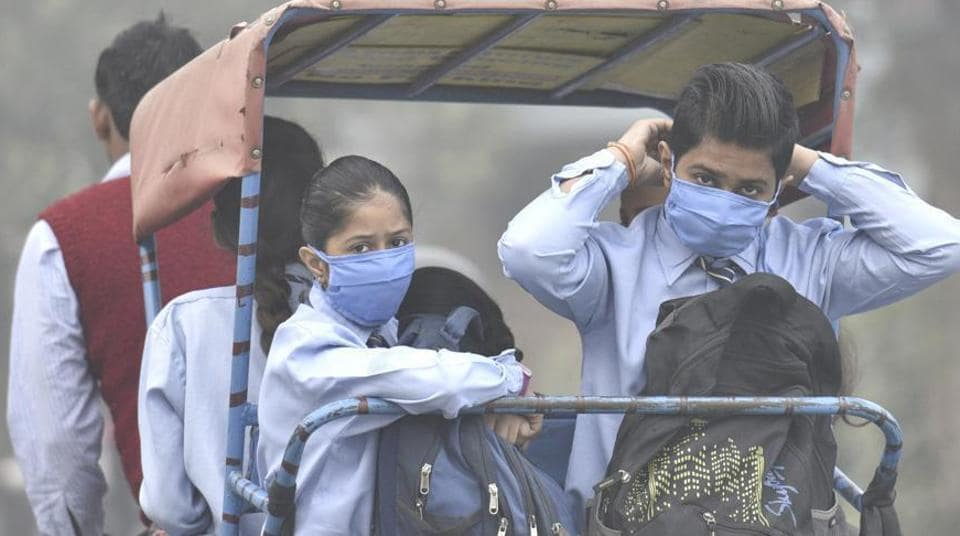 School going children wear masks to protect themselves from the toxic Delhi air in Mayur Vihar, in New Delhi, India.
