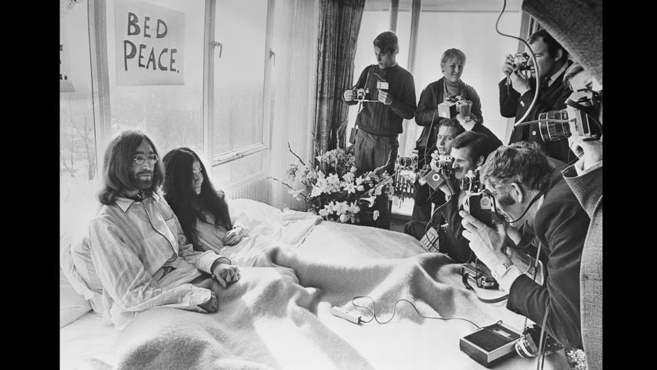 On 25th March 1969, John Lennon and his wife of a week, artist and activist Yoko Ono, received the press at their bedside in the Presidential Suite of the Hilton Hotel, Amsterdam. The couple stayed in bed for seven days 'as a protest against war and violence in the world'.  (Central Press / Getty Images)
