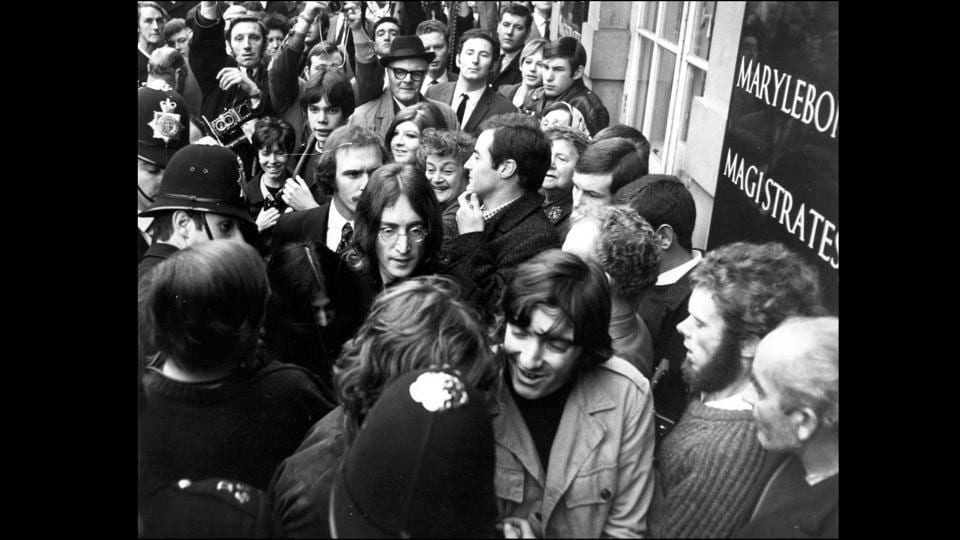 Lennon and Yoko Ono had their run-ins with the law as seen here in October 1968, when they arrived outside the Marylebone Magistrates Court, London on two charges; the illegal possession of cannabis and obstructing police in the execution of a search warrant.  (Bob Aylott / Keystone / Getty Images)