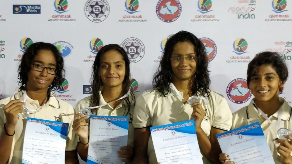 The Pune women's 4x100m relay team with their silver medals