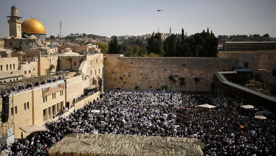 A general view shows Jewish worshippers taking part in the priestly blessing at the Western Wall of Judaism's holiest prayer site in the Old City. Sukkot is agriculturally a harvest festival, also known as Chag Ha-Asif meaning the 'festival of gathering.' (Amir Cohen / REUTERS)