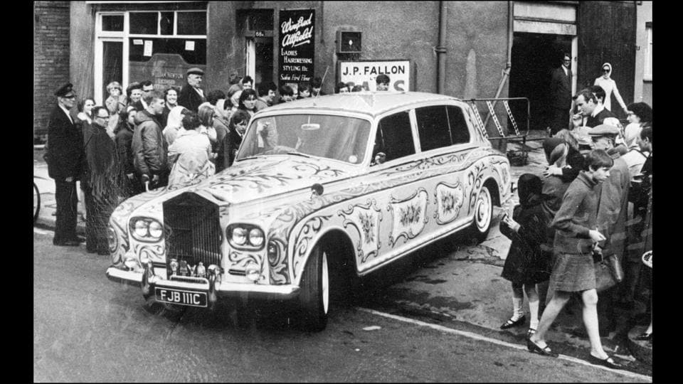 Seen driving out often in his customized Rolls Royce with fans on either side, this photograph is from Chertsey, Surrey, 1967.  (Keystone / Getty images)