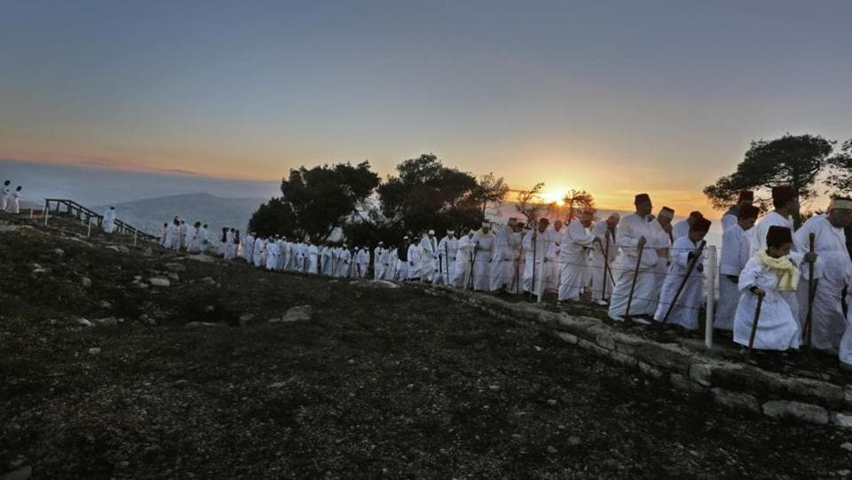 Samaritans walk up to pray on Mount Gerizim, near the city of Nablus, during the Sukkot festival. Samaritans are a community of a few hundred people living in Israel and in the Nablus area, who trace their lineage to the ancient Israelites Moses led out of Egypt. (Jaffar Ashtiyeh / AFP)