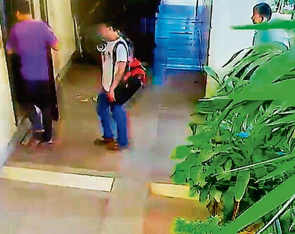 A CCTV grab showing the cook entering the house with his two accomplices.