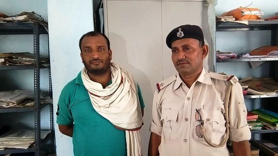 Arrested security guard Arvind Kumar Singh (left) at Bhabua police station in Bihar's Kaimur district.