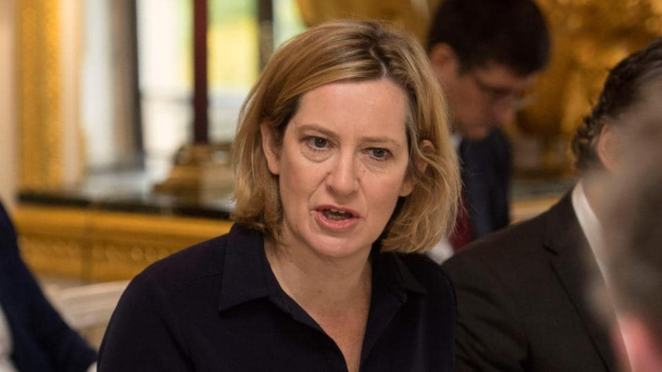 Britain's home secretary Amber Rudd talks with business leaders during the first Business Against Slavery forum at Lancaster House in central London on October 9, 2017.