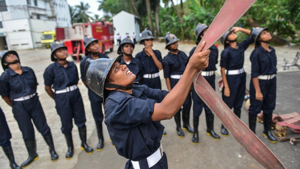 A training drill  in session for firewomen at the Wadala fire station. As part of recruitment, the women have to run a gruelling 200m track and then make a 19ft-high leap from a drill tower as part of their routine. (Aniruddha Chowdhury / Mint)