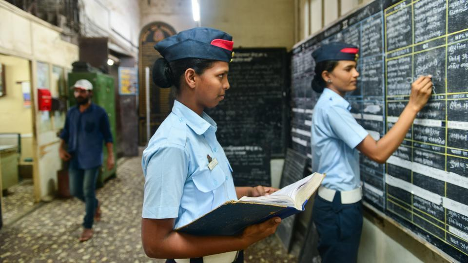 Firewoman Chhaya Pawar (extreme right) updating the duty roster at Byculla. (Aniruddha Chowdhury / Mint)