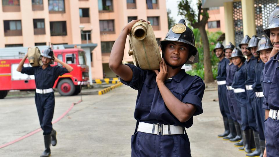 Training comprises carrying a heavy hose to douse fires and a 13kg breathing apparatus unit on the back through an obstacle course in a cage full of smoke. (Aniruddha Chowdhury / Mint)