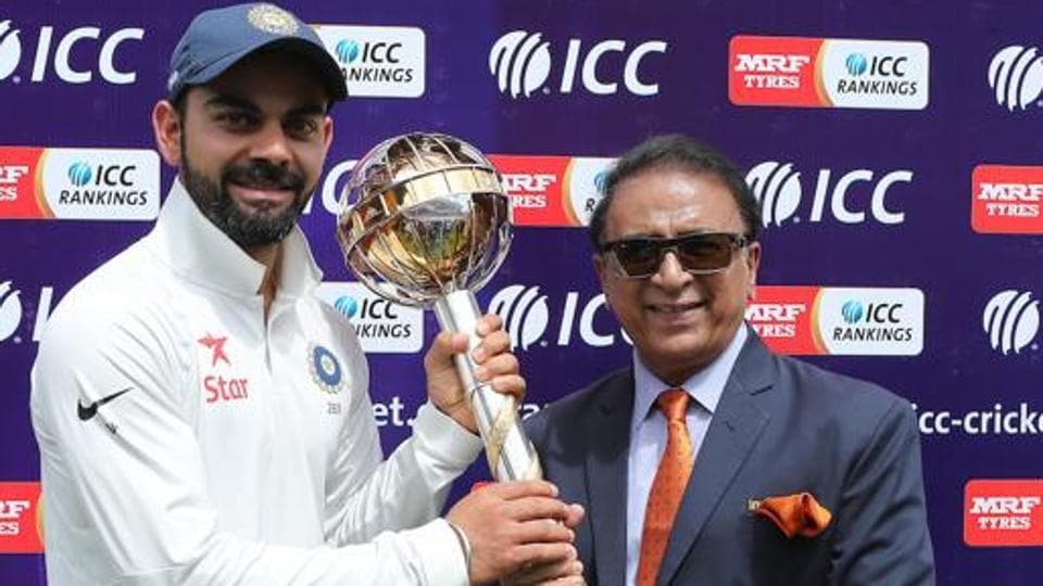Sunil Gavaskar presents Indian cricket captain the ICC Test Mace during the fourth Test match between India and Australia in Dharamsala on March 28, 2017. The ICC planning a Test championship over a two-year cycle.