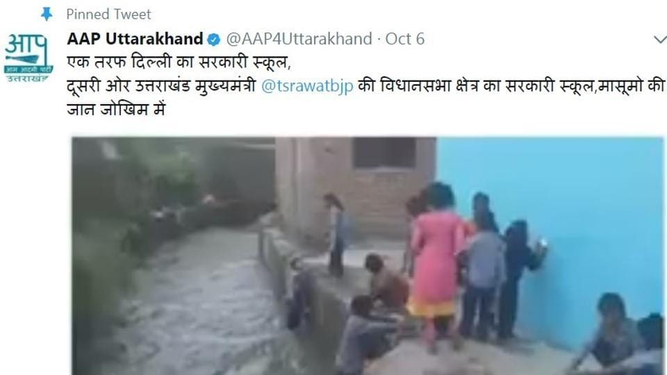 A screengrab of the video released by the Aam Aadmi Party in which students can be seen risking their lives by washing their utensils in a fast-flowing drain next to the school in Doiwala area of Dehradun.