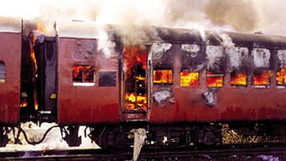 Smoke bellows from the carriage of a train on fire in Godhra, Gujarat.