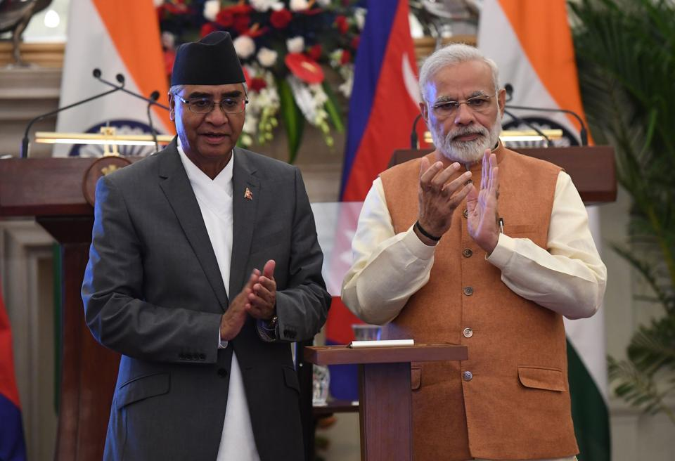 Prime Minister Narendra Modi and his Nepalese counterpart Sher Bahadur Deuba during the latter's visit to New Delhi on August 24, 2017.