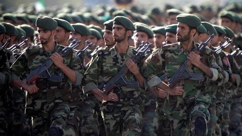 Members of Iran's Revolutionary Guards march during a military parade to commemorate the 1980-88 Iran-Iraq war in Tehran.