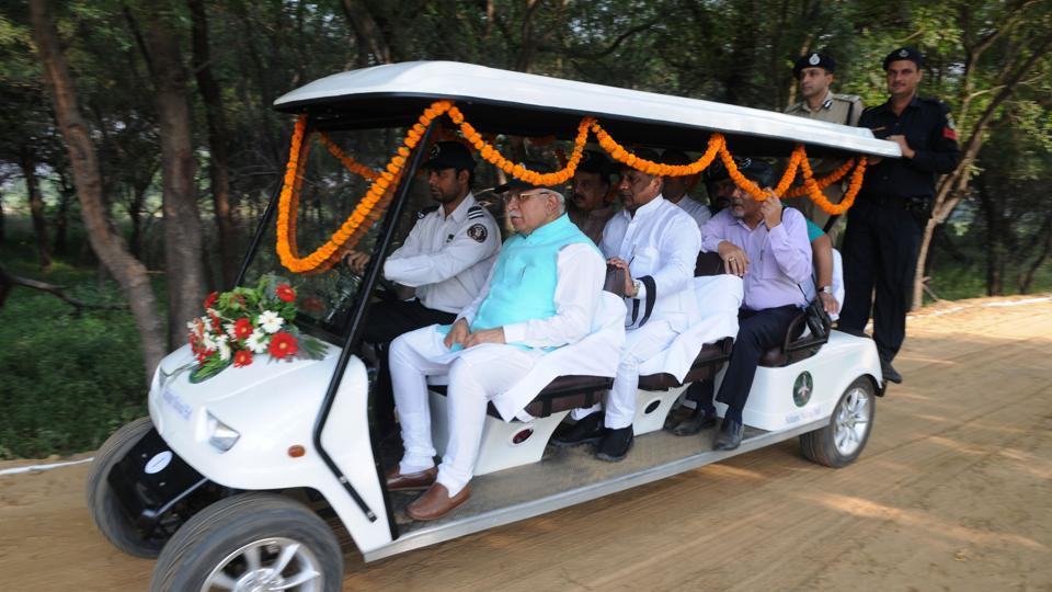 Chief minister Manohar Lal Khattar takes a ride in one of the newly launched battery carts at the Sultanpur National Park on Monday.