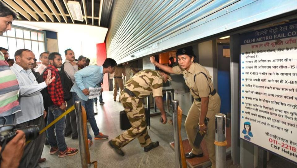 Security personnel on guard as members of the NSUI protest against the proposed hike in the fare of Delhi Metro, at Vishwavidhyalaya Metro Station on Monday.