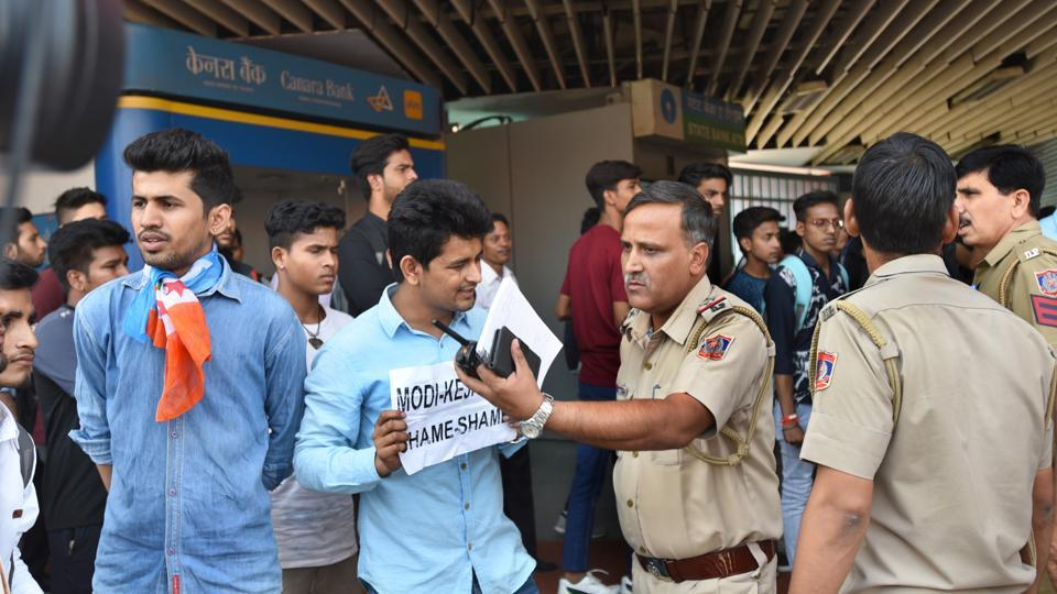 Members of the NSUI protest against the proposed hike in the fares of Delhi Metro, at Vishwavidhyalaya station on Monday.