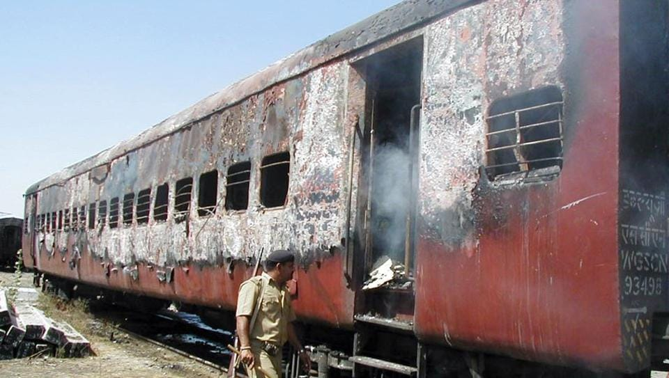 A policeman walks towards the entrance of a carriage of the train that was set on fire in Godhra, Gujarat, 2002. The Gujarat High Court commuted the death sentence of 11 convicts in the carnage case to life imprisonment on Monday (October 9)