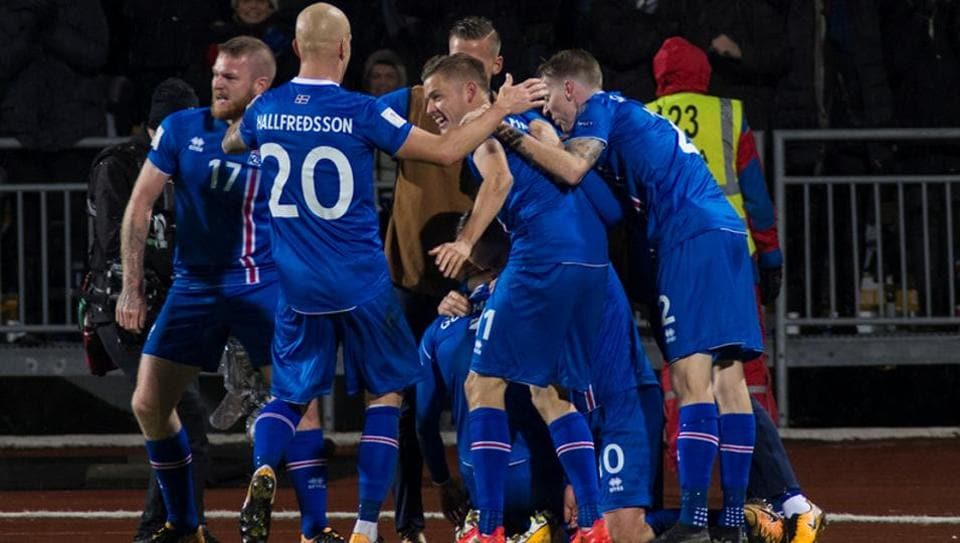 The Iceland team celebrates after winning their 2018 FIFAWorld Cup qualifier against Kosovo.