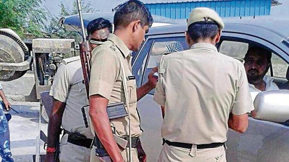 Police checking the car in which Dera Sacha Sauda head Gurmeet Ram Rahim's family came to meet him in Rohtak's Sunariya jail on Monday.
