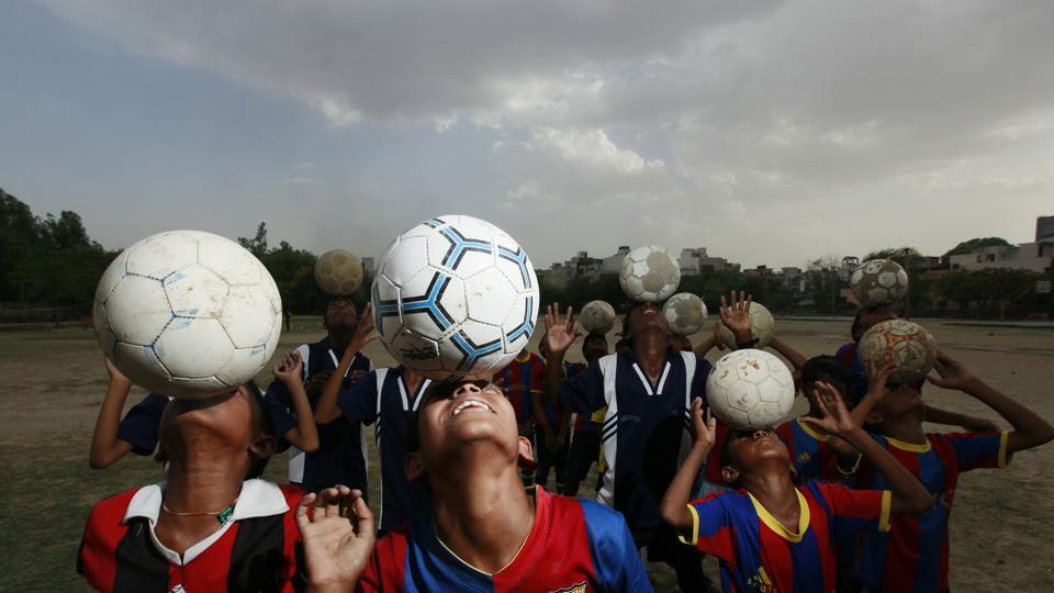 Young boys and girls from a slum in Delhi's Vikaspuri area are taking to football, trained by Sylvester Peter, who runs 'My Angels Academy.' The academy is not just a football club, rather a way out of the slums for these children. (RAJ K RAJ / HT PHOTO)