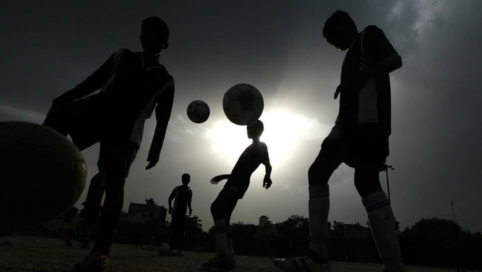 Thanks to their football coach Sylvester, who is lovingly called 'bhaiyya' by the slum's residents, many young have not been sucked into drug peddling, anti-social activities, rag picking or politics. (RAJ K RAJ / HT PHOTO)