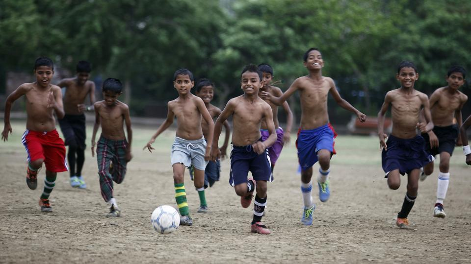 Every morning at 4 am, the young footballers, which includes several  girls, practice in the local park in Vikaspuri, making it an inclusive space and a way out of the slums for these young children. (RAJ K RAJ / HT PHOTO)