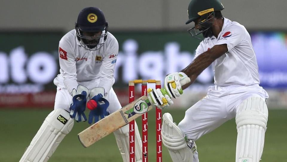 Pakistan's Asad Shafiq plays a shot during the fourth day of the second Test cricket match against Sri Lanka in Dubai on Monday. Day 5 on Tuesday is tantalisingly poised. Catch full cricket score of Pakistan vs Sri Lanka here