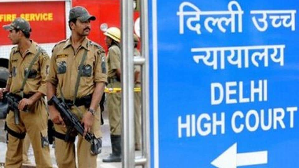 Indian police commandos stand guard in front of Delhi High Court in New Delhi.