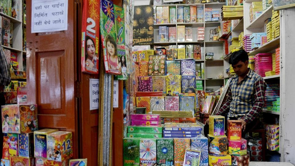 A shopkeeper at his firecracker shop in New Delhi. The Supreme Court has put on hold sale of firecrackers in Delhi-NCR till November 1.