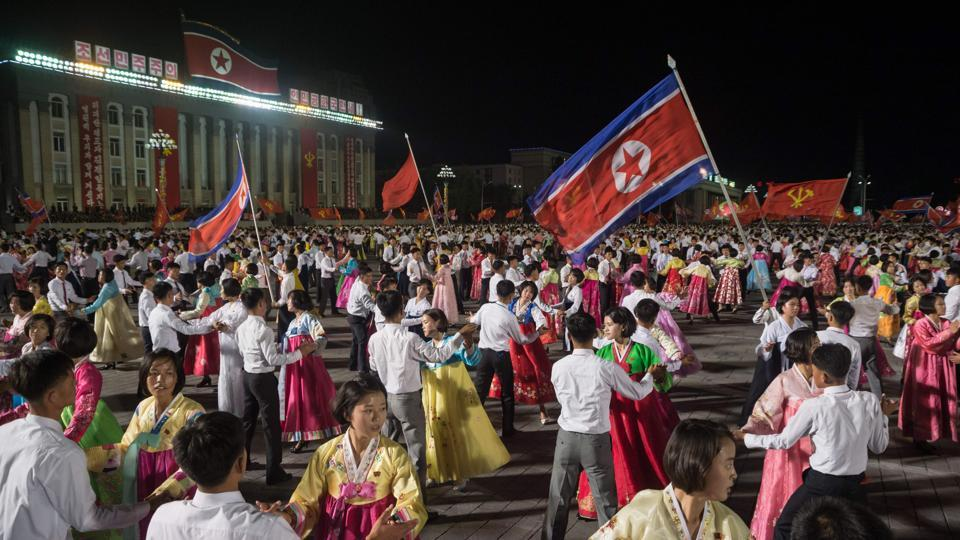 Participants described as 'working people, youth, and students of Pyongyang' perform during a mass gala event marking the 20th anniversary of late North Korean leader Kim Jong Il's election as general secretary of the Workers' Party of Korea (WPK) on Kim Il-Sung square in central Pyongyang.
