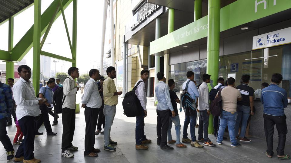 People queue up ticket counter at Huda City Center Metro Station in Gurgaon. The Delhi Metro Rail Corporation (DMRC) has decided that people who enter stations during non-peak hours will be eligible for a 20% discount even if they exit during peak hours.
