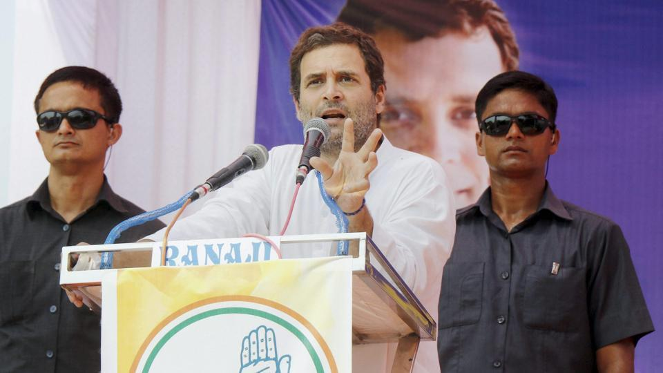 Congress vice president Rahul Gandhi addresses a gathering during a road show in Padara village in Vadodara on Tuesday.