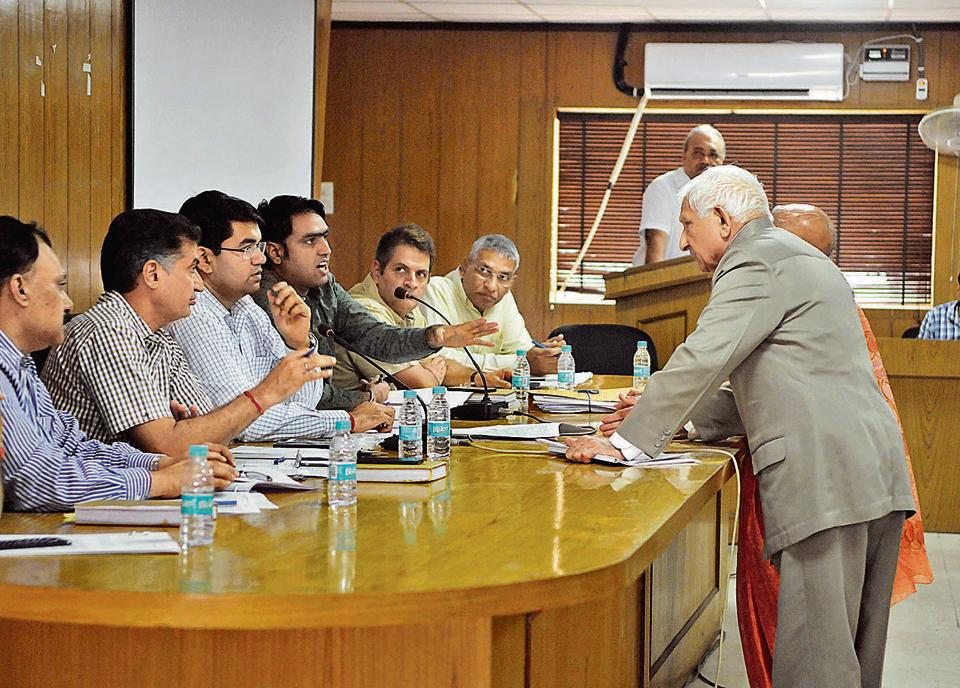 DC Vinay Pratap Singh listens to a resident's complaint at the Allottees' Grievances Redressal Forum meeting on Tuesday.