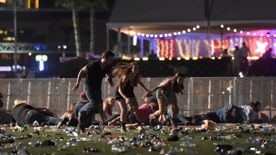 People run from the Route 91 Harvest country music festival after apparent gun fire was heard on October 1 in Las Vegas, Nevada.