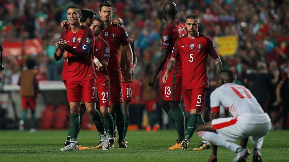 Cristiano Ronaldo celebrates with his Portugal teammates after they qualified for the 2018 FIFA World Cup after beating Switzerland.