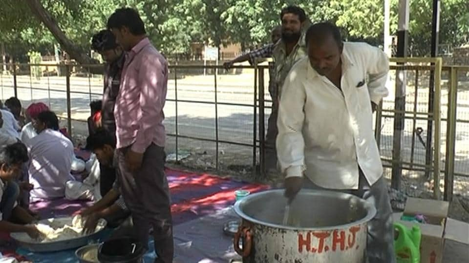 The Muslim families cook their own food after district administration failed to supply food.