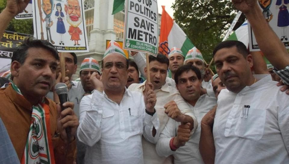 A number of Delhi Congress workers, led by party president AjayMaken, converged at Connaught Place on Wednesday evening to protest against the 'tussle between state and centre governments' over Metro fare hike.